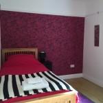 Back bedroom arranged as single room