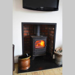 Cosy wood burning stove in lounge